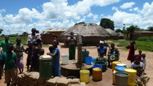 Waiting for the well to deliver water in Chipata. More pumps needed