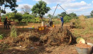 Drilling at Moses Banda's family in sandy layers