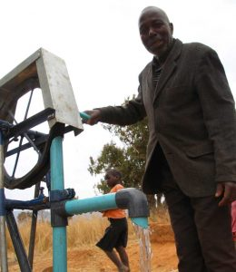 Farmer Simbani Chibwe and his pump
