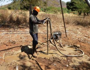 Edward drilling at James Mbewe