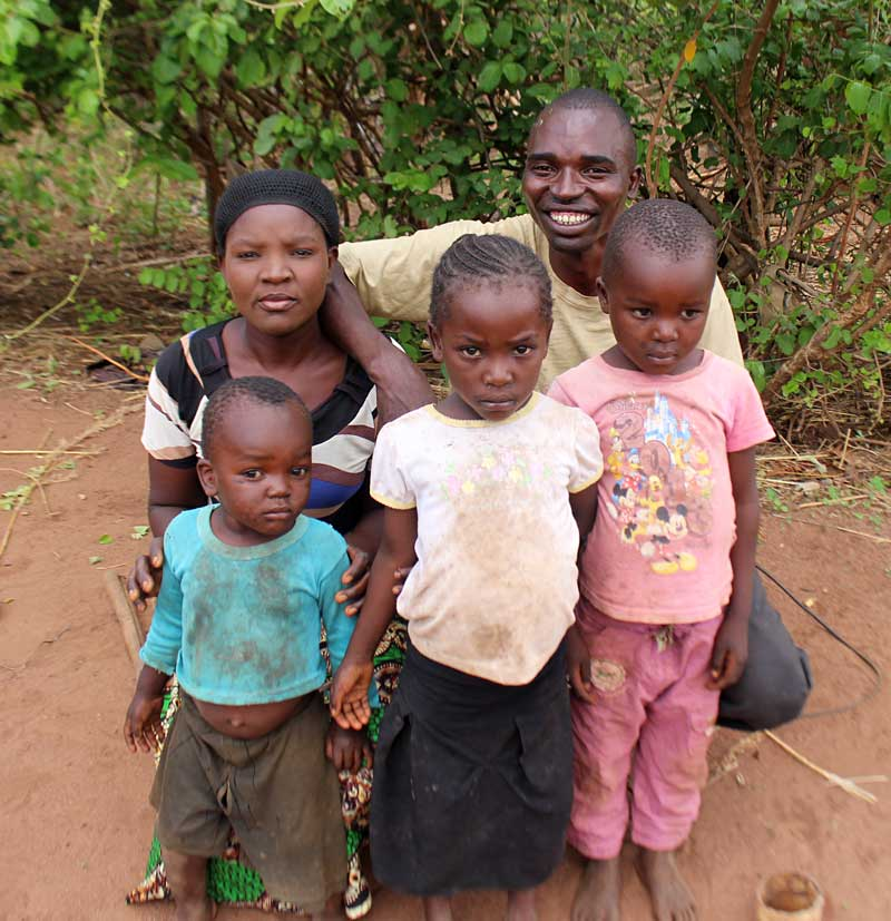 Aseli and his wife and three of his five children.
